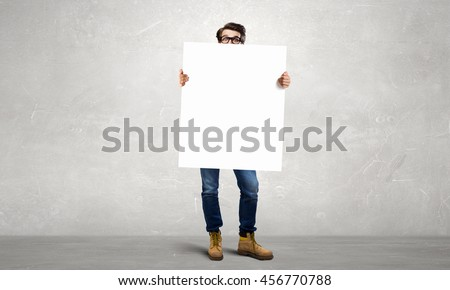 Businessman with blank banner  . Mixed media