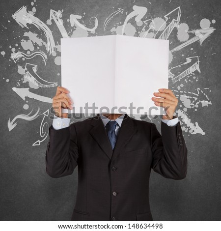 businessman with blank book and arrows choice as concept - stock photo