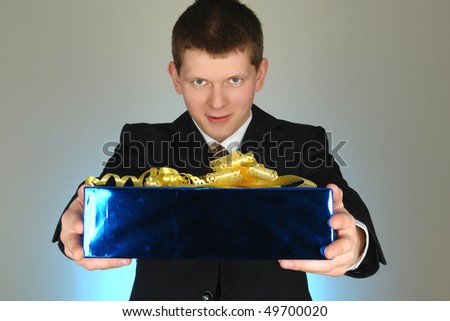 businessman with blue box present