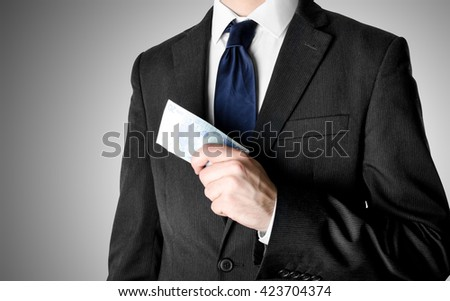 Businessman with blue tie holding twenty euro bank notes. - stock photo
