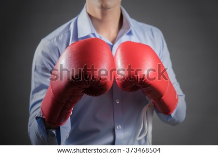Businessman with boxing gloves .Photo for magazine ,or design work