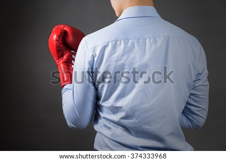 Businessman with boxing gloves .Photo for magazine ,or design work - stock photo