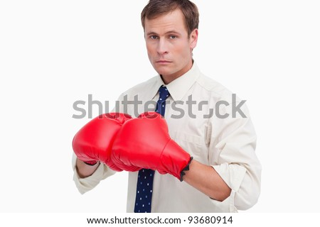 Businessman with boxing gloves ready to fight against a white background - stock photo