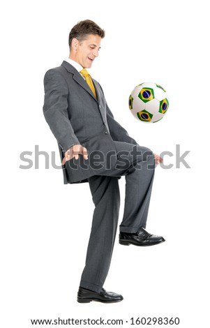 Businessman with Brazilian flag soccer ball isolated in white - stock photo