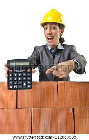Businessman with bricks on white
