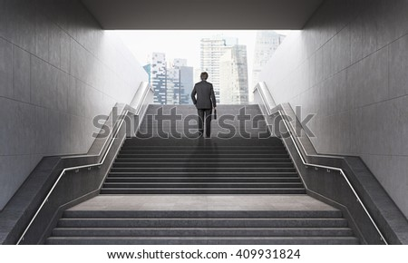 Businessman with briefcase climbing stairs in pedestrian subway, going to the city. Concept of success. New York. 3D Rendering