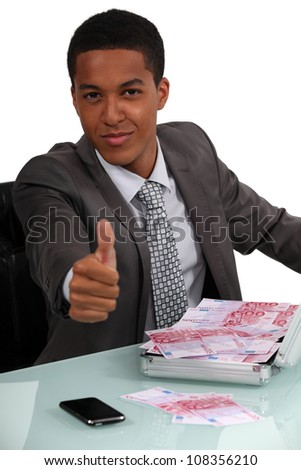 Businessman with briefcase full of bills - stock photo