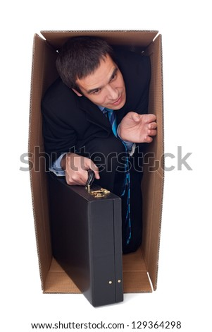 Businessman with briefcase inside of a cardboard box