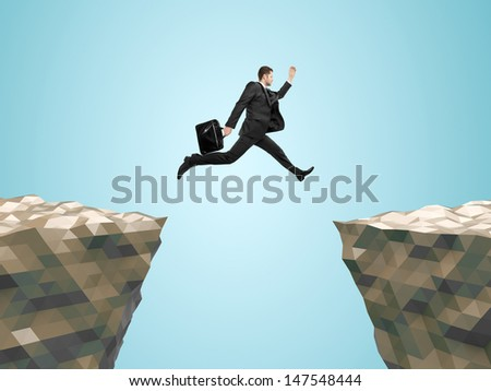 businessman with briefcase  jumping from mountain to mountain - stock photo