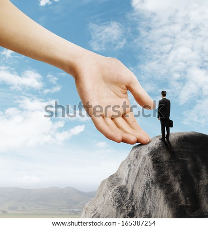 businessman with briefcase standing on mountain - stock photo