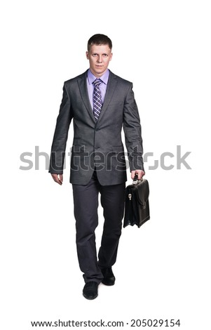 Businessman with briefcase walking, isolated on white - stock photo