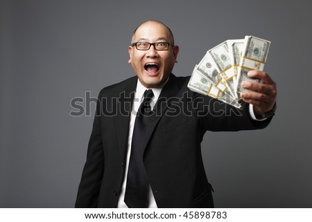 Businessman with bundles of cash.
