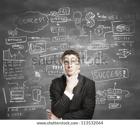 businessman with business plan concept on desk - stock photo