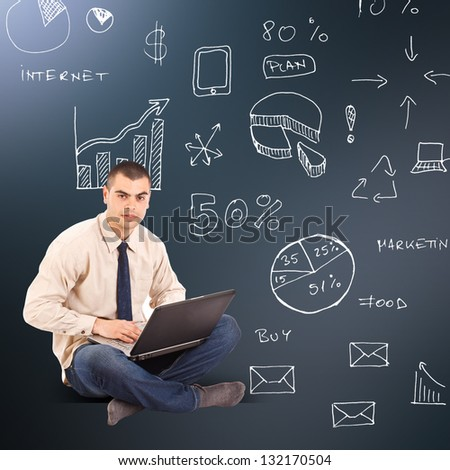 Businessman with business scheme and icons - stock photo