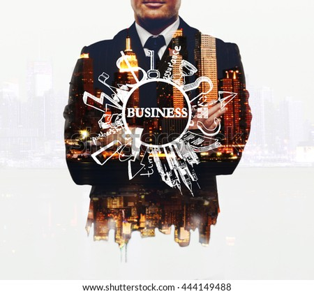 Businessman with business sketch on night city background. Double exposure. Business concept - stock photo