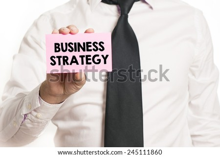 Businessman with business strategy. Businessman holding paper with business strategy text isolated over white background - stock photo