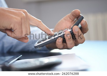businessman with calculator - stock photo
