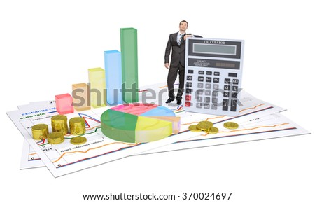 Businessman with calculator and graphs