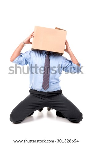 Businessman with cardboard box in his head - stock photo