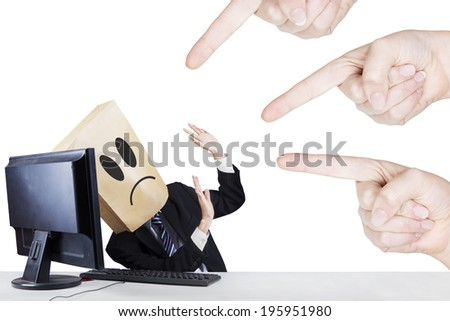 Businessman with carton head bullied by fingers. isolated on white background - stock photo