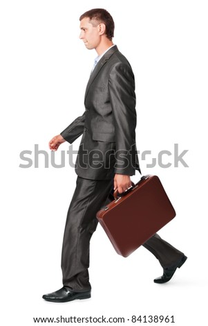 businessman with case walking, isolated on white background - stock photo
