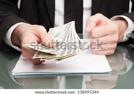 Businessman with cash money - stock photo
