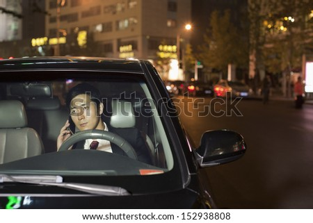 Businessman With Cell Phone In Car - stock photo
