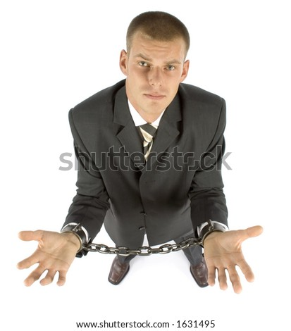 businessman with chains on his hands - stock photo