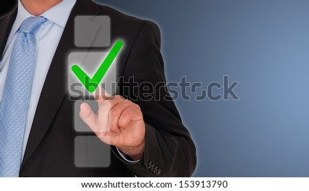 Businessman with Checklist - stock photo