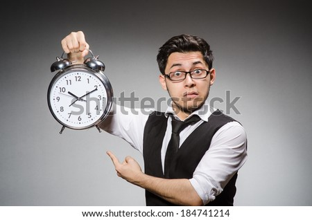 Businessman with clock in time concept - stock photo