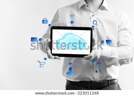 Businessman with  cloud computing diagram on tablet-pc, modern technology concept