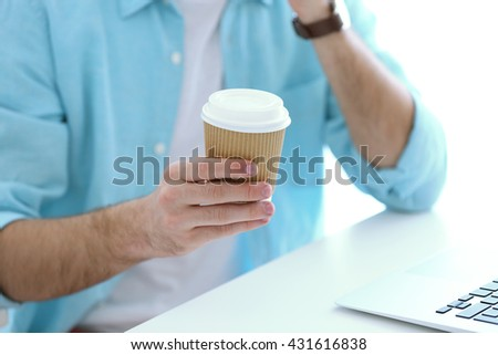 Businessman with coffee working in the office - stock photo
