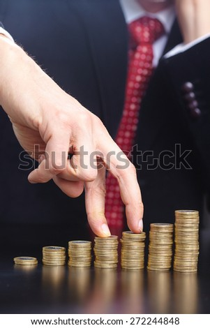 businessman with coins - stock photo