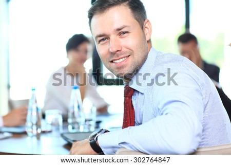 Businessman with colleagues in the background