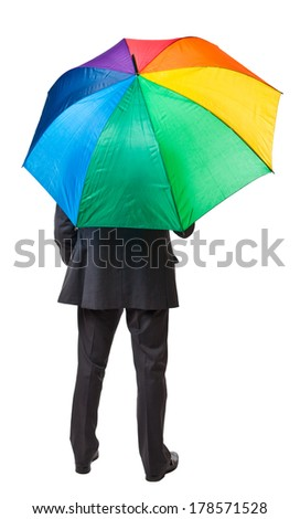 businessman with colorful umbrella back view - stock photo