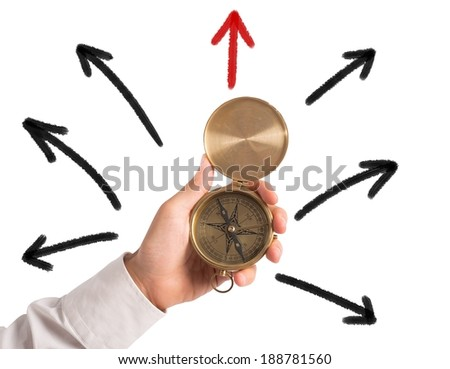 Businessman with compass looking for the correct way - stock photo
