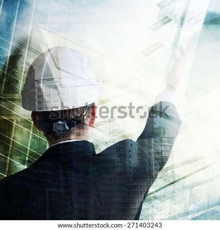Businessman with construction helmet
