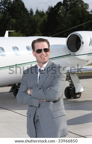 Businessman with corporate jet - stock photo