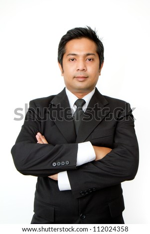 Businessman with crossed arms smiling on a white background - stock photo