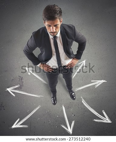 Businessman with different directions you can take - stock photo