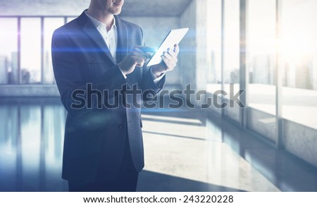 Businessman with digital tablet - stock photo