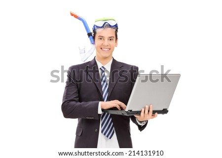 Businessman with diving equipment holding laptop isolated on white background