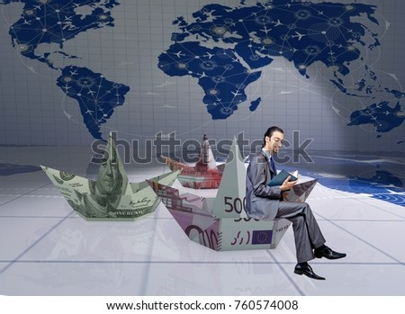 Businessman with dollar paper boats