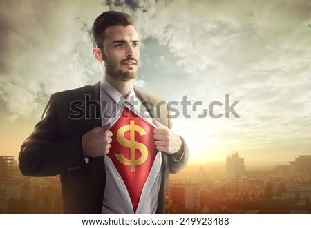 Businessman with dollar sign as superhero - stock photo