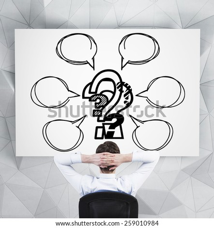 businessman with drawing scheme with question mark on desk