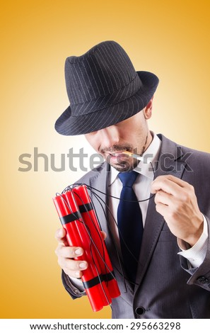 Businessman with dynamite against the gradient  - stock photo