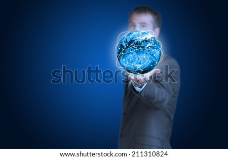 Businessman with Earth and glowing lines