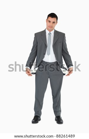 Businessman with empty pockets against a white background