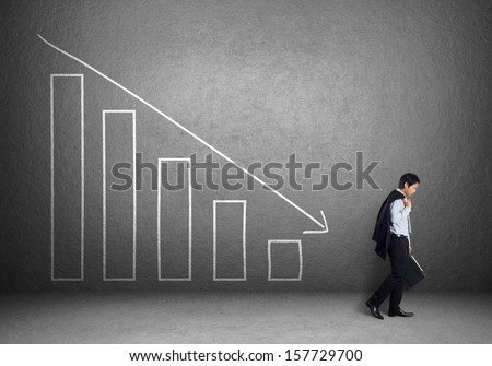 Businessman with failure chart - stock photo