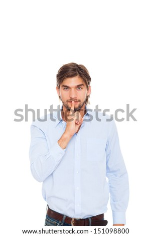 businessman with finger on lips smile, handsome young business man, concept of silence, commercial financial secret isolated over white background - stock photo
